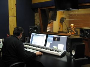 Amicus Strings Jacqui recording a television commercial with mixing guy